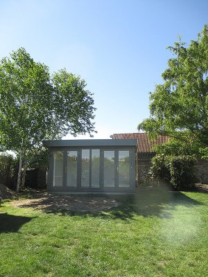 Salthouse Studio with overhanging pent roof and shiplap cladding