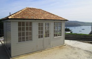 3.0 x 4.2m Cley Summerhouse painted in Farrow & Ball Old White with a Hipped Roof covered in Cedar Shingle tiles