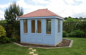 2.4 x 3.0m Cley Summerhouse in Sundrenched Blue with a Hipped Roof covered in Terracotta Slate Effect Tiles