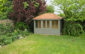 2.4 x 3.6m Cley Summerhouse in Ash with a Hipped Roof covered in Cedar Shingle tiles