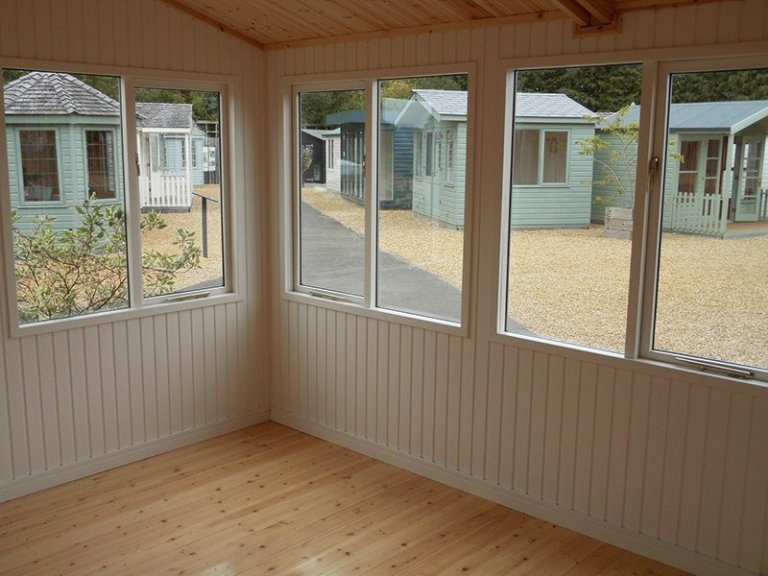 The desk height windows and Ivory painted matchboard inside the 3.6 x 4.2m Langham Studio at Burford