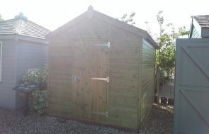 2.4 x 3.0m Superior Shed in Sikkens Green at Brighton with sun flare in photo