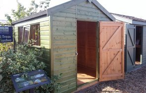 2.4 x 3.0m Superior Shed in Sikkens Green at Brighton with open door