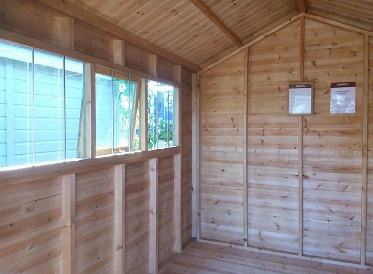 Inside the 2.4 x 3.0m Superior Shed in Sikkens Green at Brighton