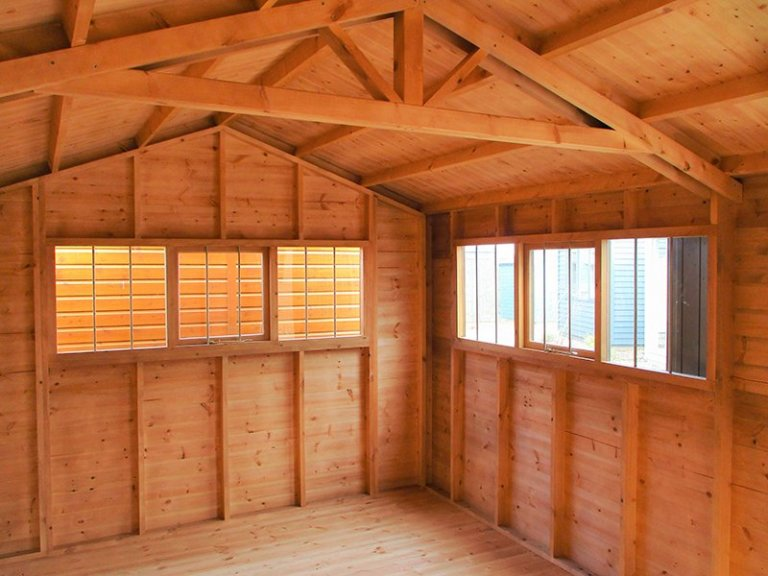 The windows inside the 3.0 x 4.2m Superior Shed in Sikkens Walnut at Brighton