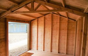 The door and roof truss inside the 3.0 x 4.2m Superior Shed in Sikkens Walnut at Brighton