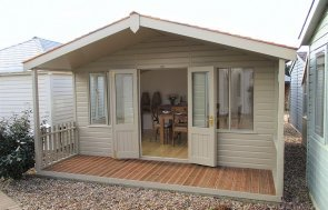 Side view of the 4.2 x 4.8m Morston Summerhouse in Taupe at Brighton