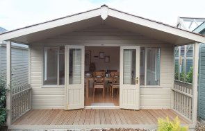 Front view of the 4.2 x 4.8m Morston Summerhouse in Taupe at Brighton