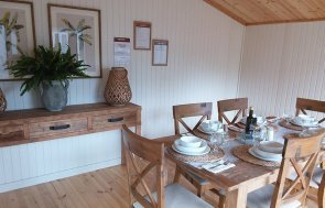 Interior shot of the 4.2 x 4.8m Morston Summerhouse in Taupe at Brighton