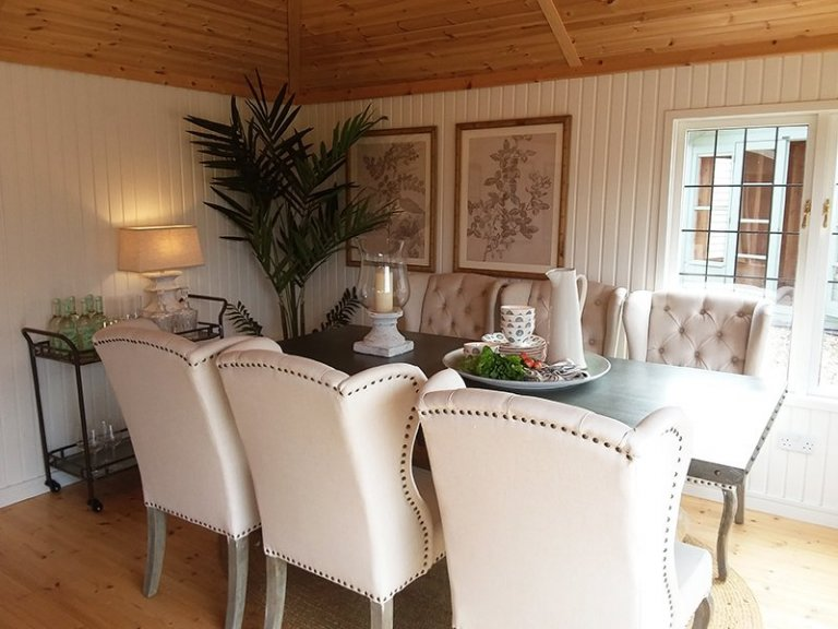 Dining room table and chairs inside the Garden Room at Brighton