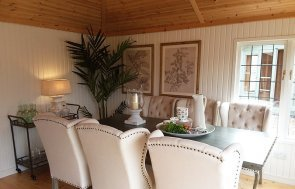 Dining room table and chairs inside the Sandstone painted Garden Room at Brighton