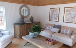 Sofa area inside the Sandstone painted Garden Room at Brighton
