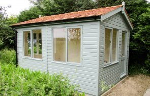 3.0 x 4.2m Langham Studio in Sage paint with full insulation and cedar shingle roofing tiles