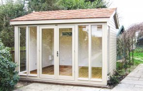 3.0 x 3.6m Burnham Studio in Taupe paint with cedar shingle roofing tiles