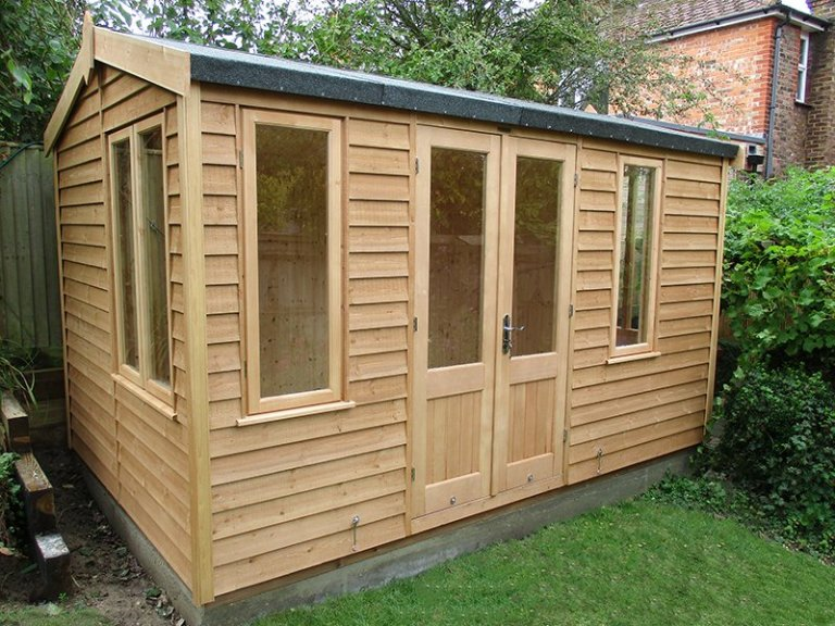 2.4 x 3.6m Light Oak Holkham Summerhouse with Weatherboard Cladding