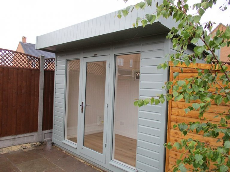 6 x 10ft Salthouse Studio in Sage with shiplap cladding and Ivory painted matchboard lining