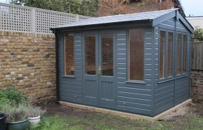 2.4 x 3.0m Holkham Summerhouse with shiplap cladding painted in Slate from our exterior paint system