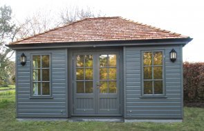 Garden Room with inset doors, cedar shingle tiles on the hipped roof, and painted in the colour Ash