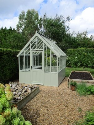 2.4 x 3.0m Lizard Painted Greenhouse with one slatted workbench inside
