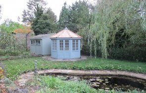 3.0 x 3.0m Wiveton Summerhouse painted in Sage from our exterior paint system with Georgian Windows