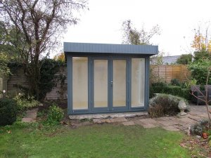 2.4 x 3.0m Salthouse Studio with shiplap cladding painted in Slate
