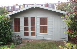 4.8 x 2.4m Blakeney Summerhouse with Storage Partition painted in Sage