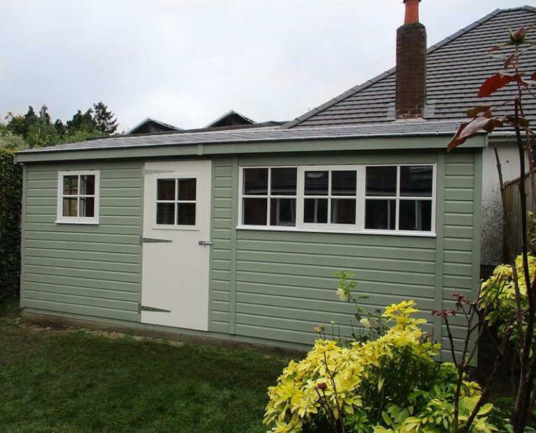 3.0 x 5.4m Superior Shed with storage partition painted in Lizard & Ivory from our exterior paint system