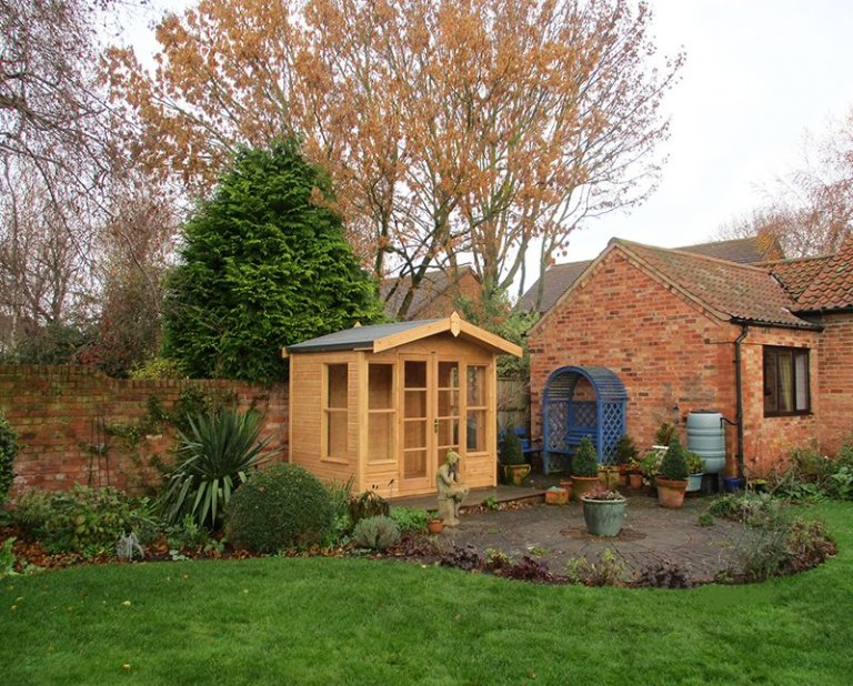 2.4 x 1.8m Blakeney Summerhouse in Light Oak Preservative with Heavy Duty Roofing Felt on the Apex Roof