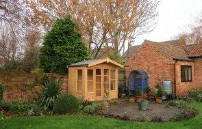 2.4 x 1.8m Blakeney Summerhouse in Light Oak Preservative with Heavy Duty Roofing Felt on the Apex Roof