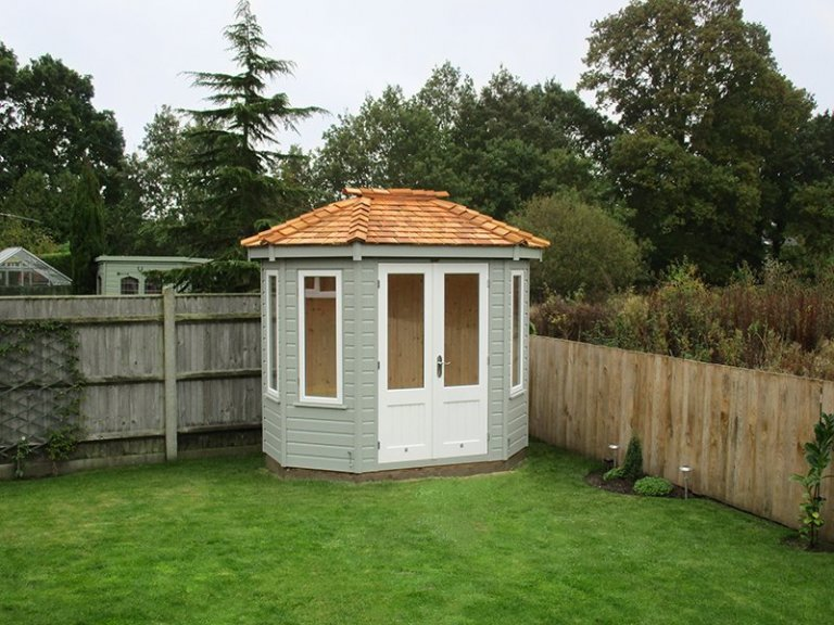1.8 x 2.5m Wiveton Summerhouse painted in two-tone Farrow & Ball Wimborne White and Pigeon