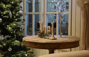 A festive-looking Pavilion Garden Room adorned with outside lights