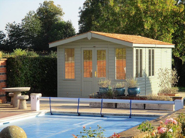 3.0 x 5.4m Blakeney Summerhouse with storage partition painted in Lizard from our exterior paint system