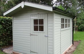 8 x 12ft Superior Shed with Apex Overhang painted in Lizard from our exterior paint system