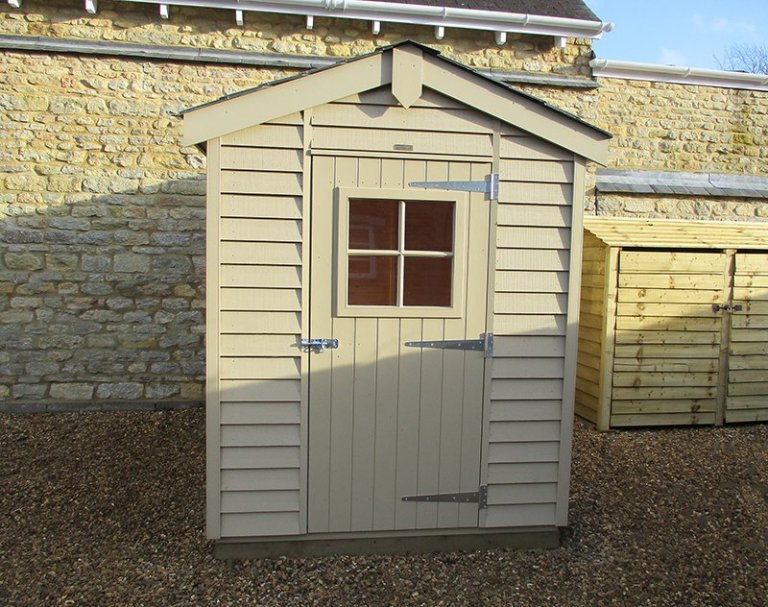 1.8 x 2.4m Superior Shed with rustic weatherboard cladding, painted in the colour Taupe