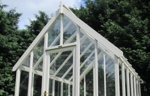 2.4 x 3.0m Timber Greenhouse painted in Ivory with plenty of glazing