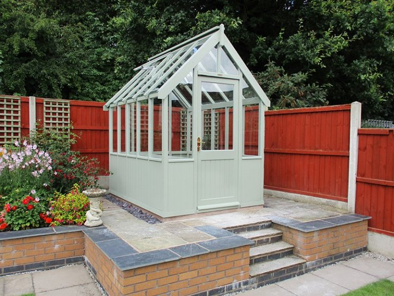 1.8 x 2.4m Greenhouse in Lizard with one slatted oak-faced plywood workbench