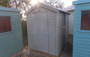 Burford Classic Shed 1.5 x 2.1m in Stone with an apex roof covered in heavy duty roofing felt