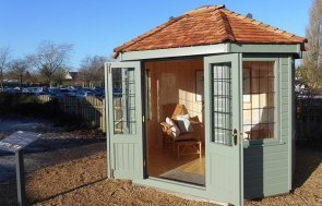 Burford Wiveton Summerhouse 2.4 x 3.0m with open doors painted in Farrow & Ball Card Room Green