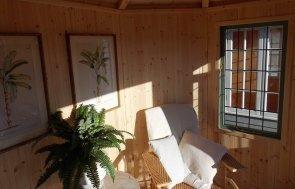 Inside the Burford Wiveton Summerhouse 2.4 x 3.0m painted in Farrow & Ball Card Room Green