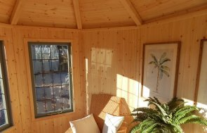 An Internal View of the Burford Wiveton Summerhouse 2.4 x 3.0m painted in Farrow & Ball Card Room Green