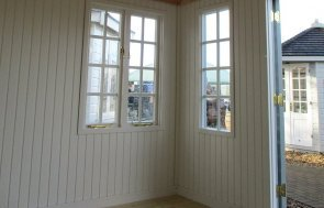 An internal view of the Brighton Cley Summerhouse 3.0 x 3.6m in Verdigris