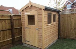 1.5 x 2.1m Rustic Superior Shed with Weatherboard Cladding treated with a Light Oak Preservative