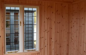 Inside the Narford 2.4 x 3.0m Cley Summerhouse in Cream