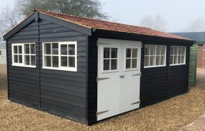 3.6 x 5.4m Superor shed painted in black and ivory with Georgian windows at St Albans Show Centre