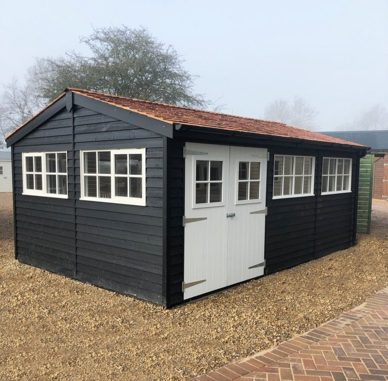 Superor shed painted in black and ivory with Georgian windows at St Albans Show Centre