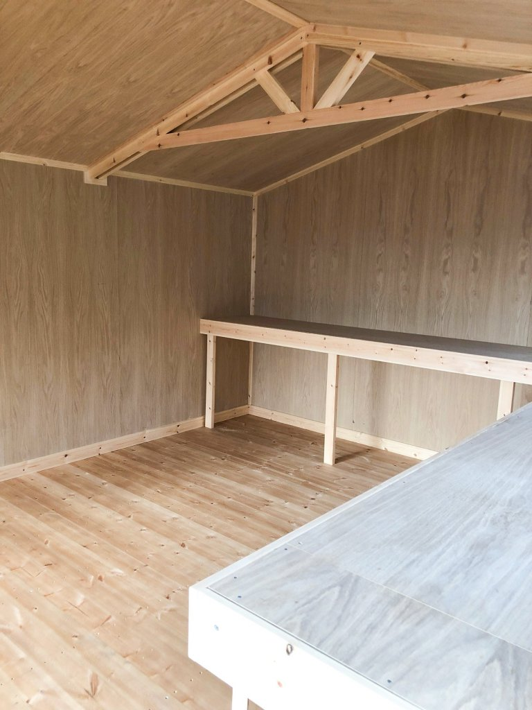 Interior of a Superior Shed with Oak Faced Ply Lining and workbenches
