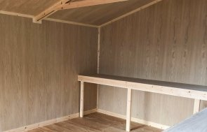 Interior of a 3.6 x 5.4m Superior Shed with Oak Faced Ply Lining and workbenches