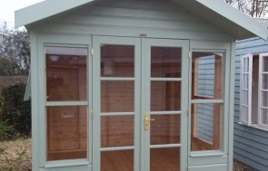 Side view of the Brighton 2.4 x 2.4m Blakeney Summerhouse in Lizard