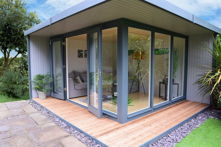 3.8 x 4.4m Holt Garden Corner Studio with veranda and roof overhang