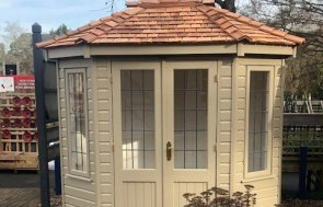 Front view of the Sunningdale 1.8 x 2.5m Wiveton Summerhouse painted in Taupe